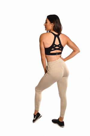 Load image into Gallery viewer, Black sports bra and tan leggings