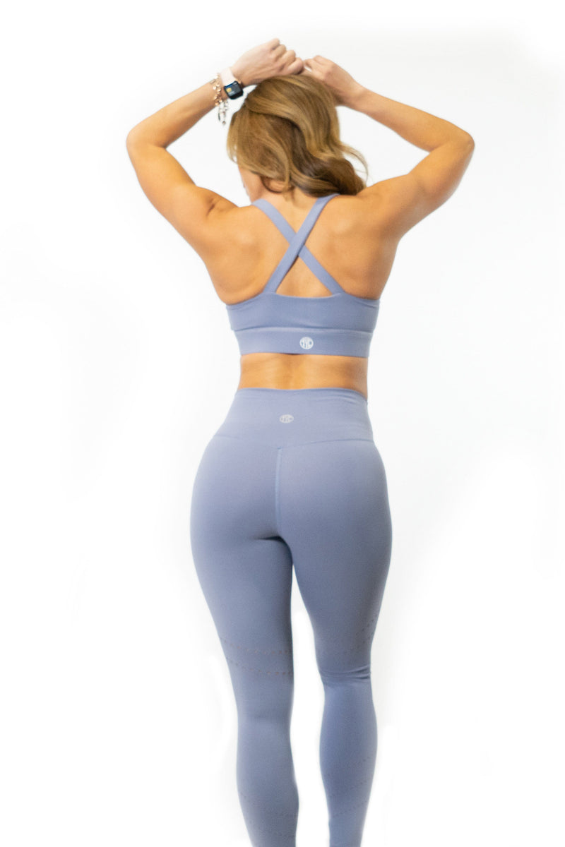 Back of matching periwinkle sports bra and leggings