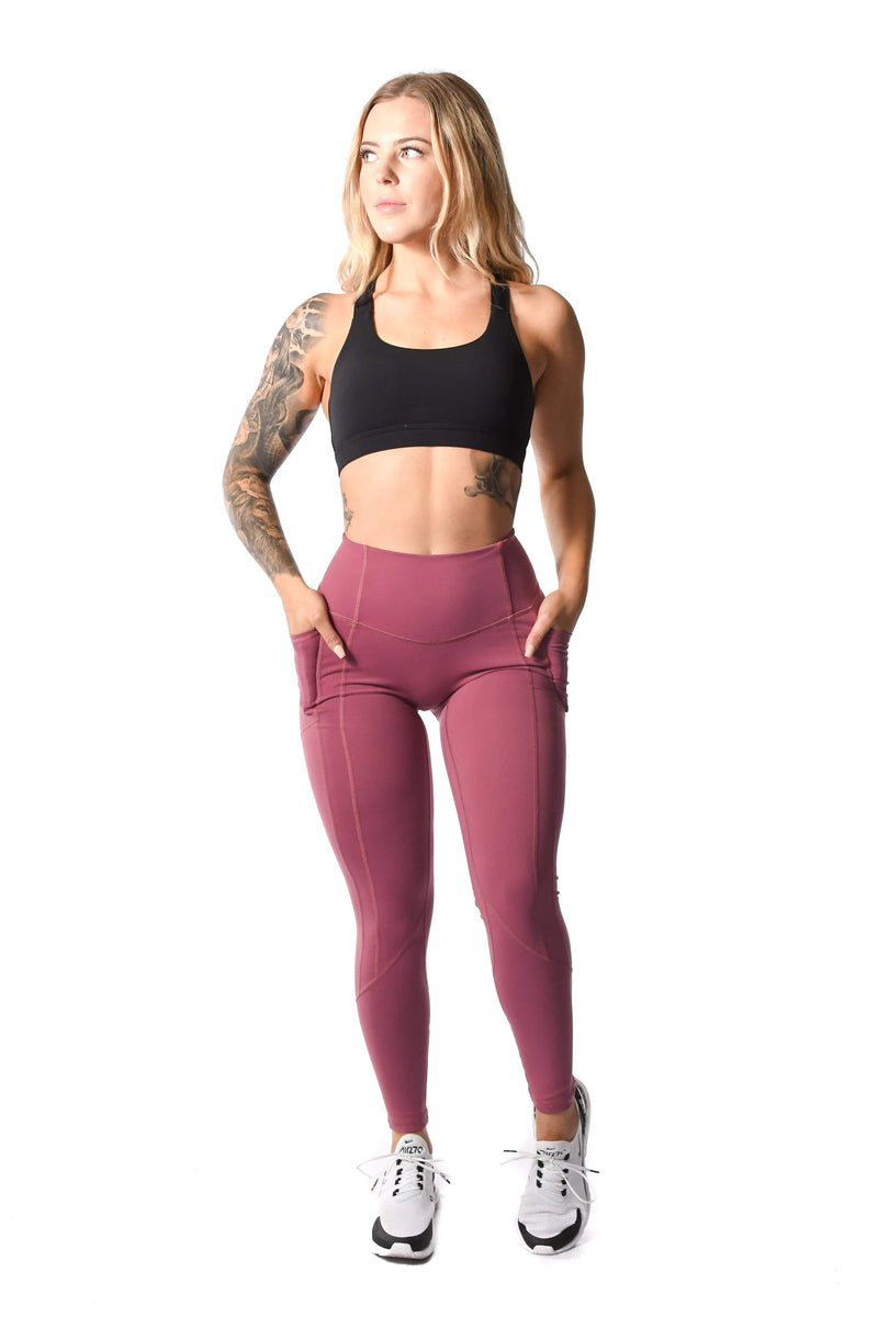 Black sports bra and pink leggings