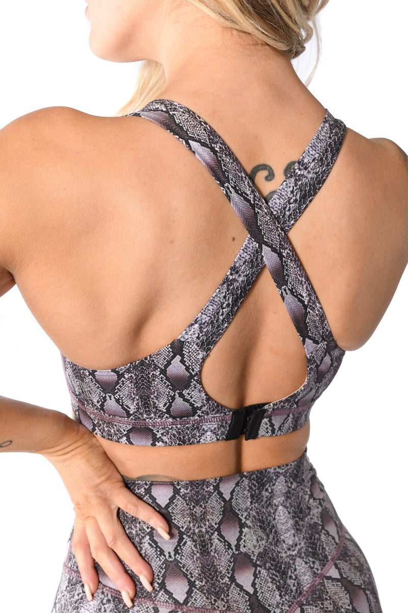 criss cross design back of snakeskin sports bra