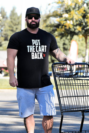 "Bearded man wearing black T-shirt with quote ""Put the cart back"""