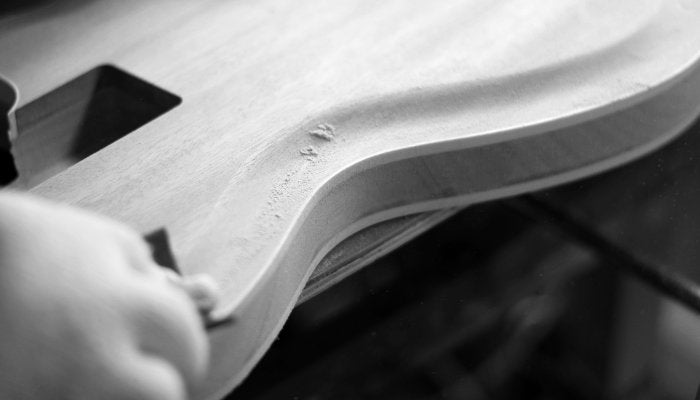 An Eastwood guitar getting sanded
