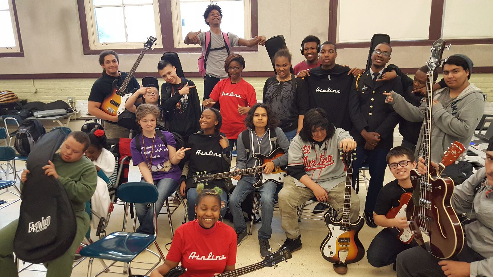 Robert Lindblom Math and Science Academy kids with Eastwood guitars