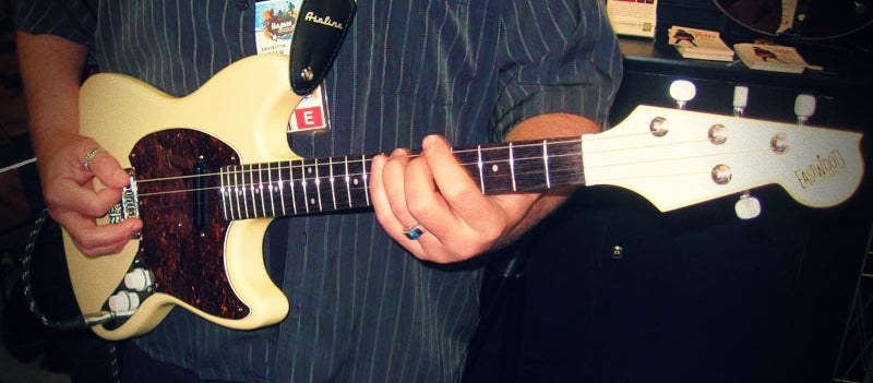 playing a tenor guitar