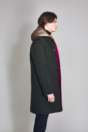 Loden Coat in 100% extra-fine merino wool, woven leather buttons.