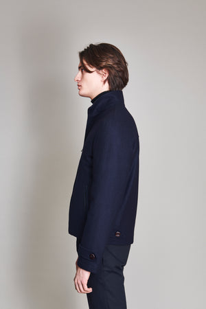 Jacket in 100% extra-fine merino wool lined in nylon.
