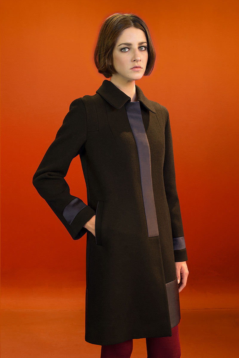 Loden coat with silk Mikado details.