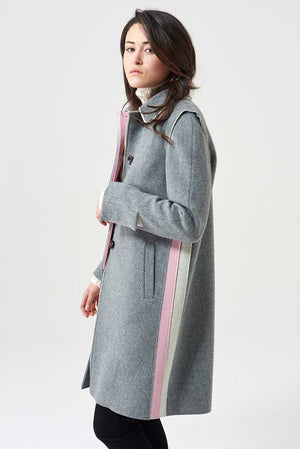Coat in loden fabric with raw-cut inserts on the sides