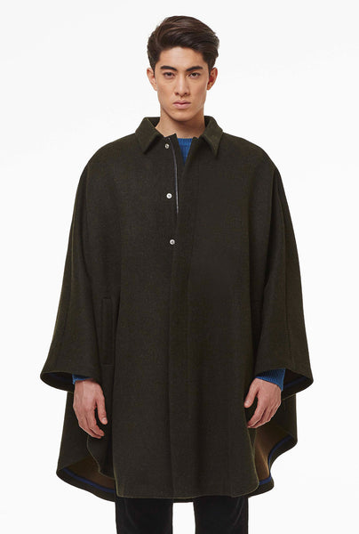 Loden cape with hidden zip.