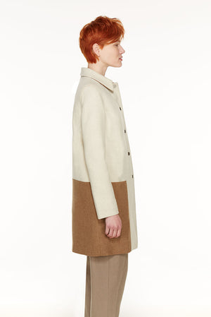 Loden coat with geometric insert in contrast colour.