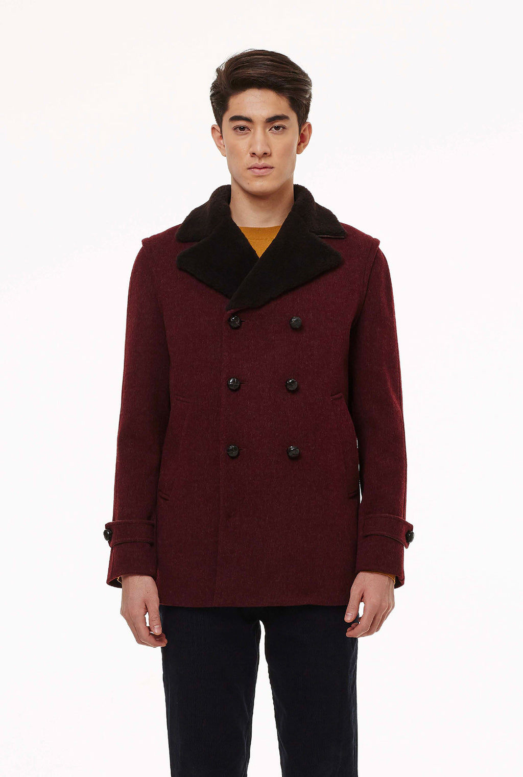 Peacoat in loden fabric with fur.