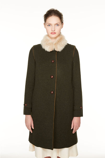 Raw edges loden coat with fur.