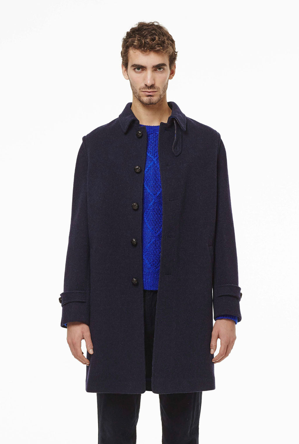 Classic loden coat with details in check fabric.