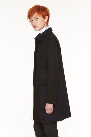 Loden coat with geometric insert.