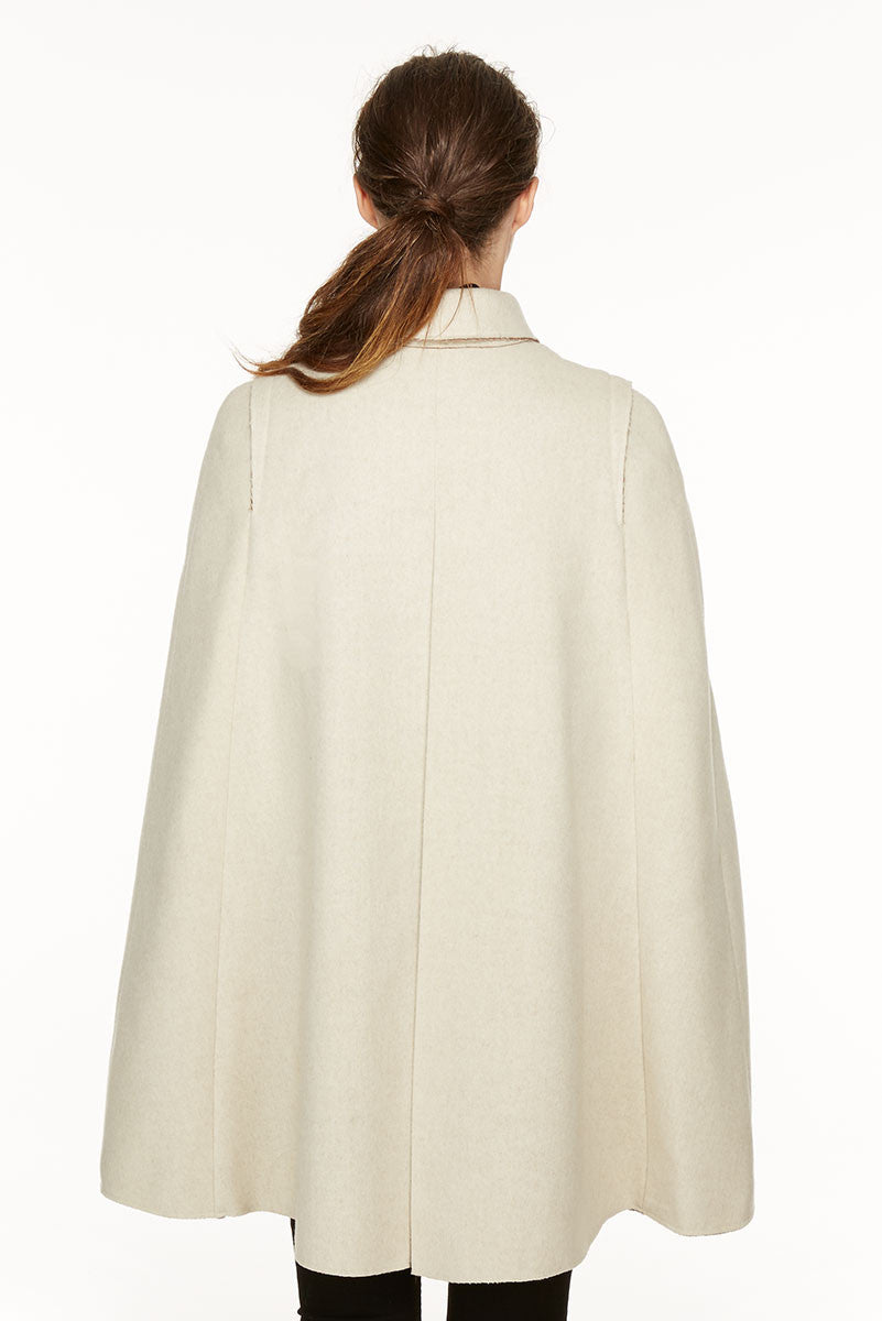 Raw-edges cape in loden fabric
