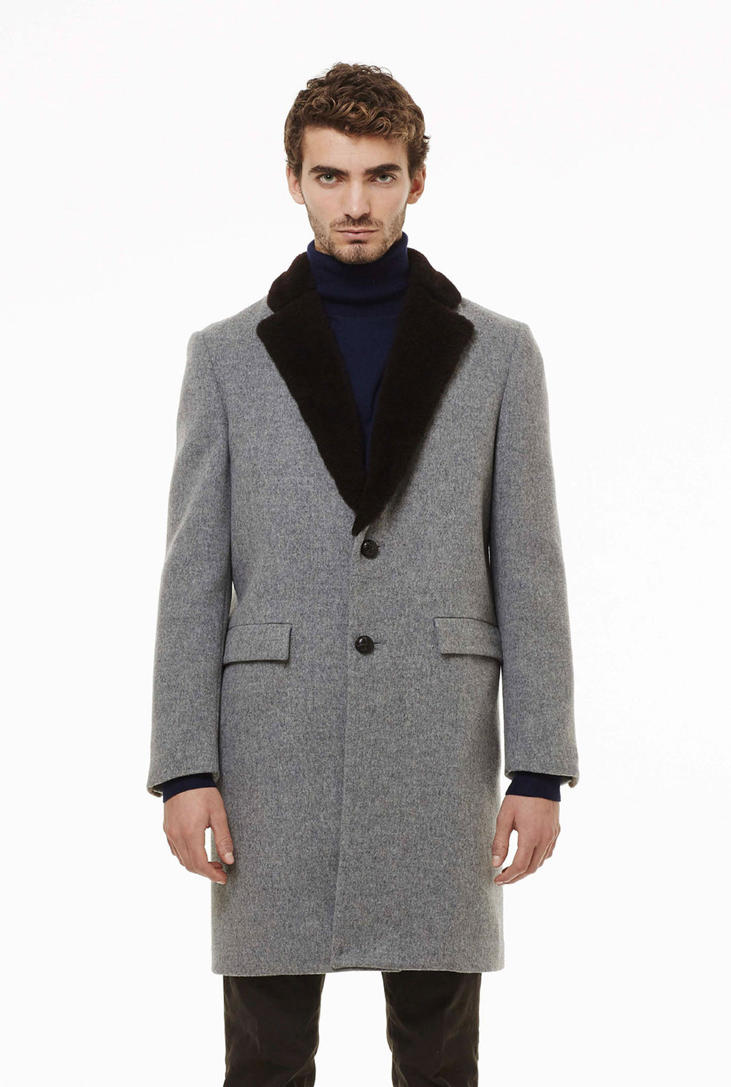 Two-buttons coat in loden fabric with fur.