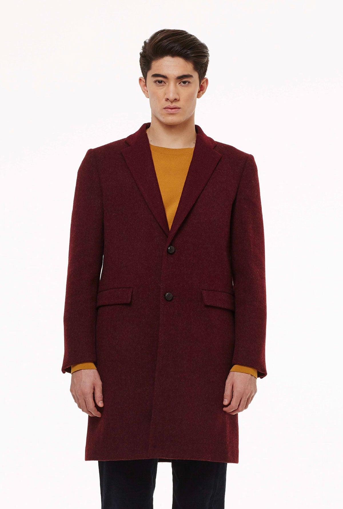 Two-buttons coat in loden fabric.