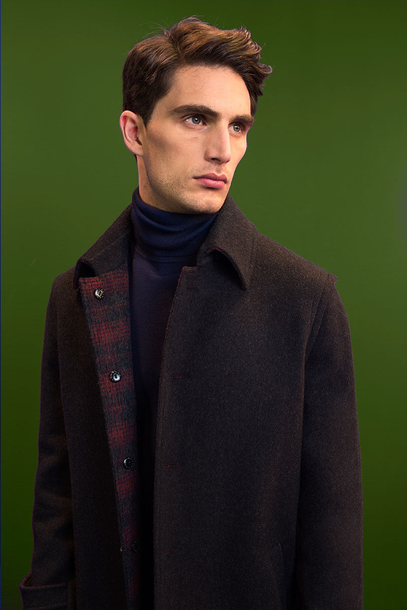 Loden coat with check lining.