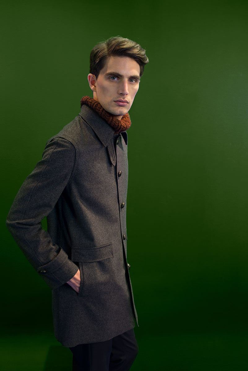 ¾ loden coat lined with waterproof cotton.