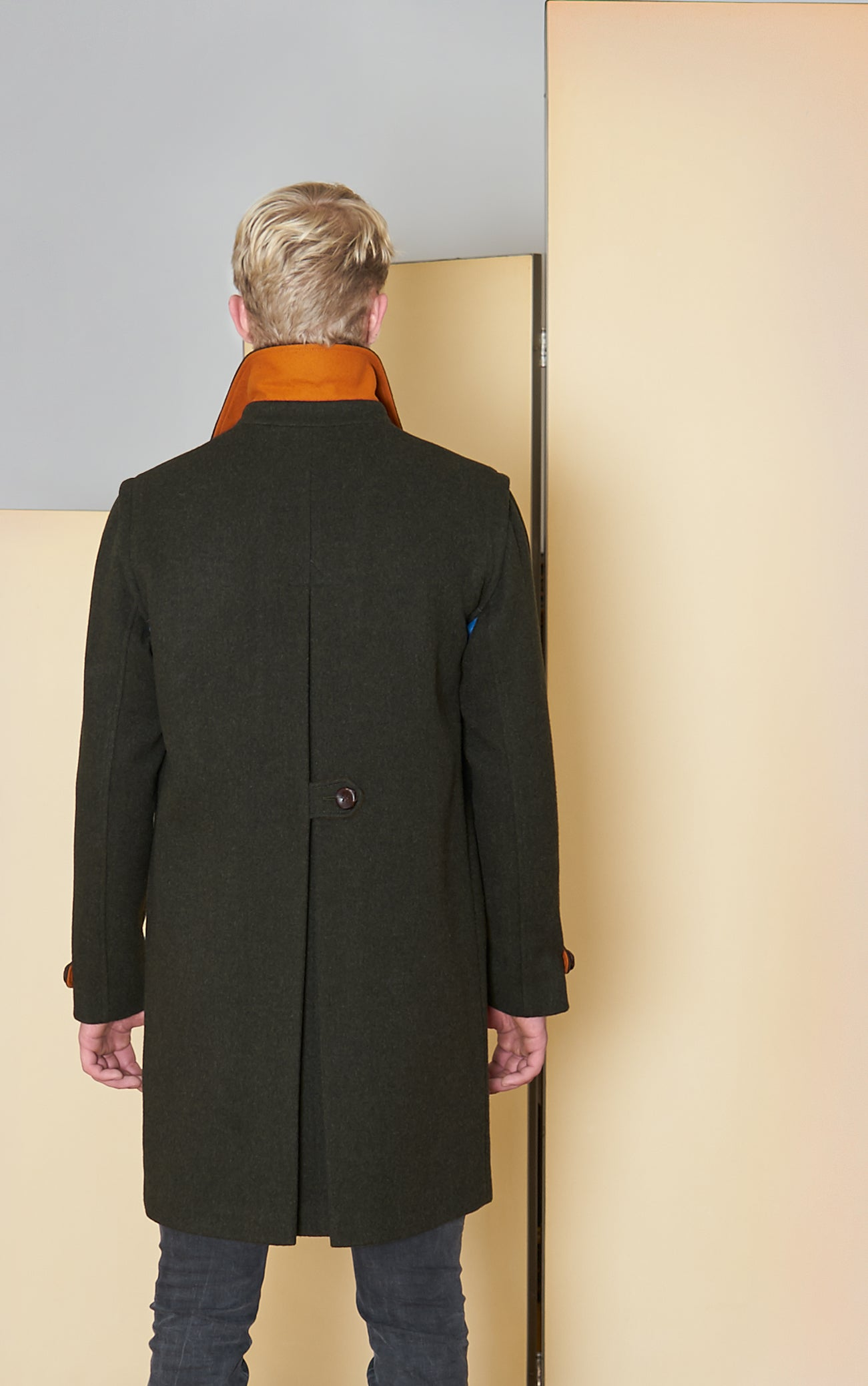 Classic Loden Coat in 100% extra-fine merino wool and woven leather buttons.