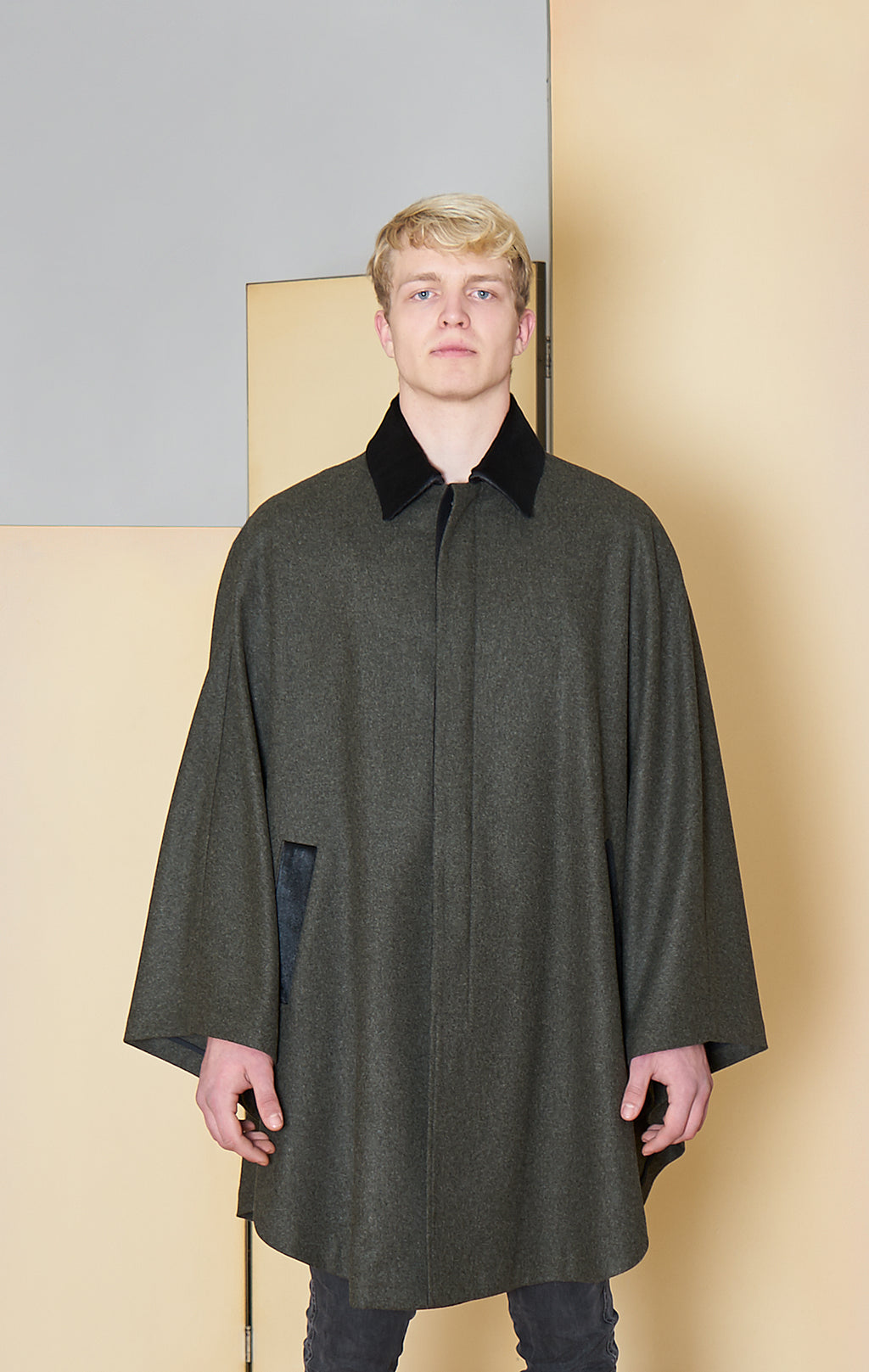 Cape in 100% extra-fine merino wool with ponyskin details.
