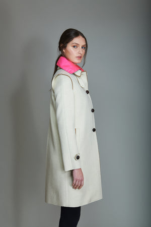Classic Loden Coat in 100% extra-fine merino wool and raw edges details.
