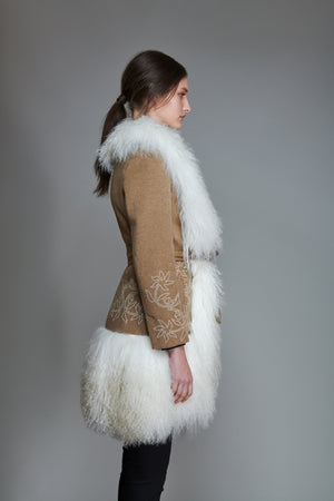 Belted coat with mongolian fur collar and profiles.