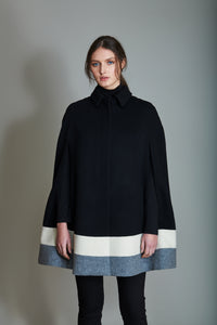 Cape in 100% extra-fine merino wool with striped intarsia.