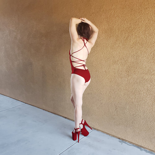 red sexy and strappy bodysuit for pole dance, raves, and festivals