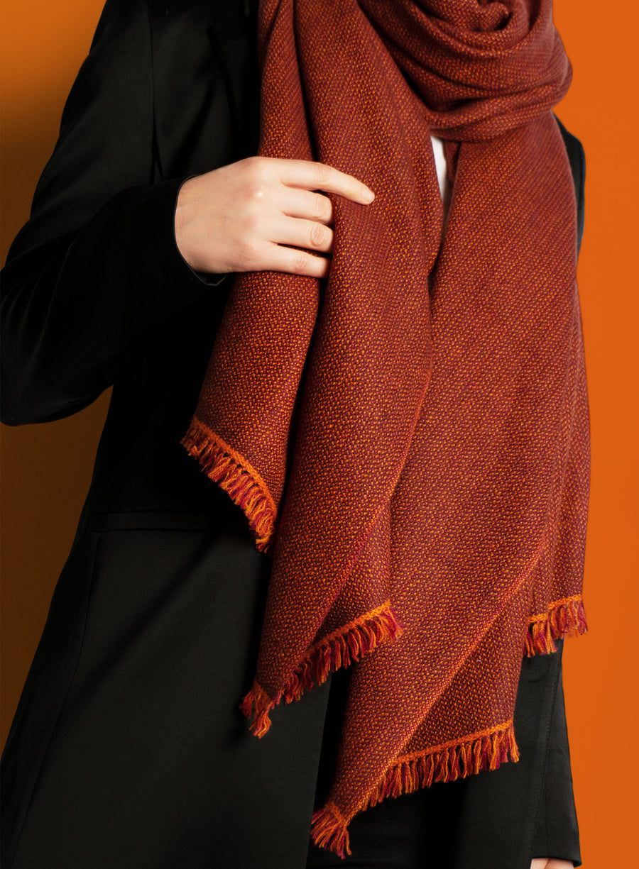 Orange red coloured, sustainable wool scarf