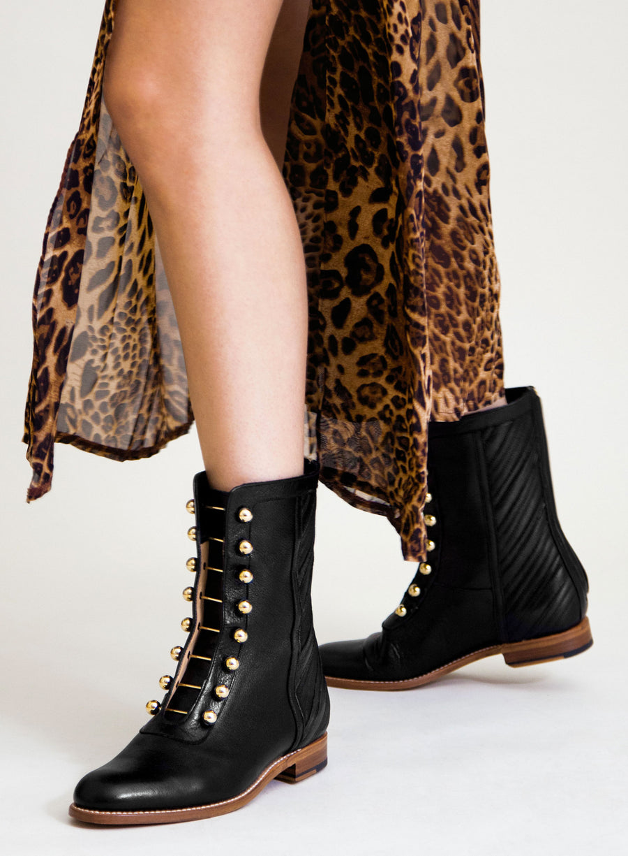 Goodyear welted, black coloured sustainable ankle boot with golden piercings by ALINASCHUERFELD