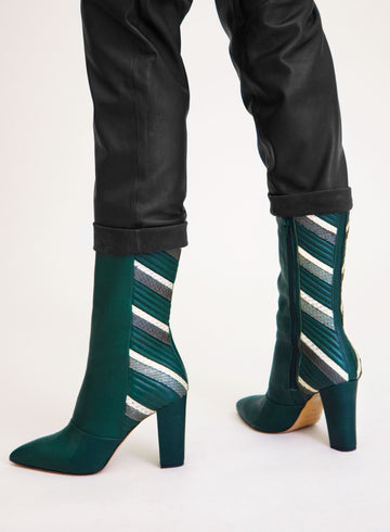 Green and white coloured sustainable boot by ALINASCHUERFELD