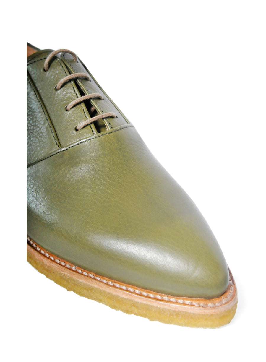 Goodyear welted, olive coloured sustainable flat shoe with a crepe sole  Edit alt text