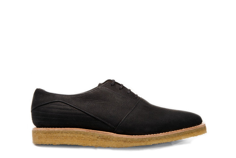 Goodyear welted, black coloured sustainable flat shoe with a crepe sole by ALINASCHUERFELD