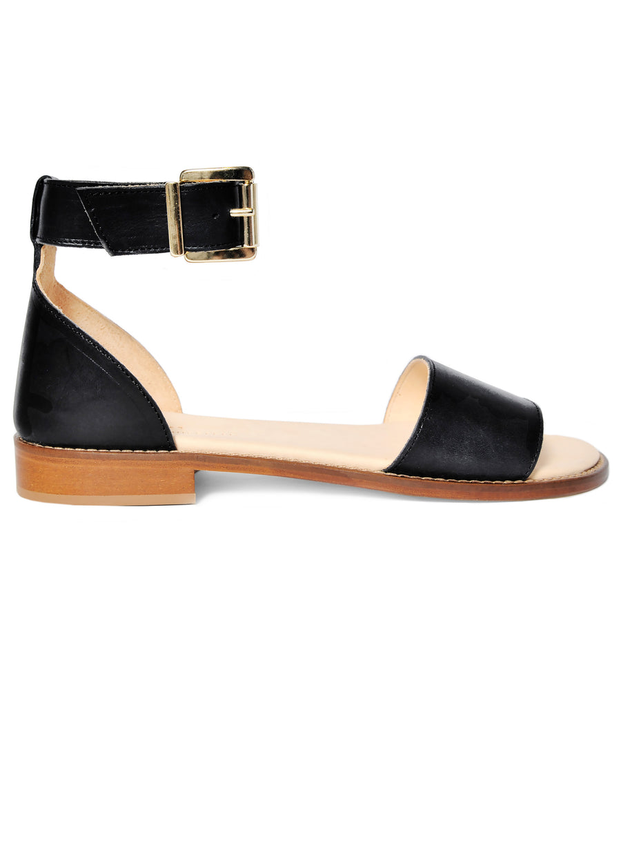 Black coloured sustainable sandal with golden buckles by ALINASCHUERFELD