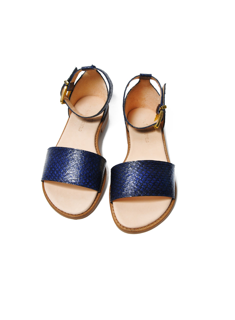 Dark blue coloured sustainable sandal with golden buckles by ALINASCHUERFELD
