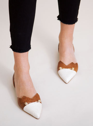 White and brown coloured, sustainable LOULOU Loafer with golden piercings by ALINASCHUERFELD