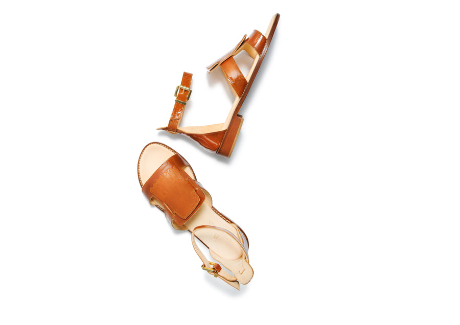 Brown coloured, sustainable patent leather sandal by ALINASCHUERFELD