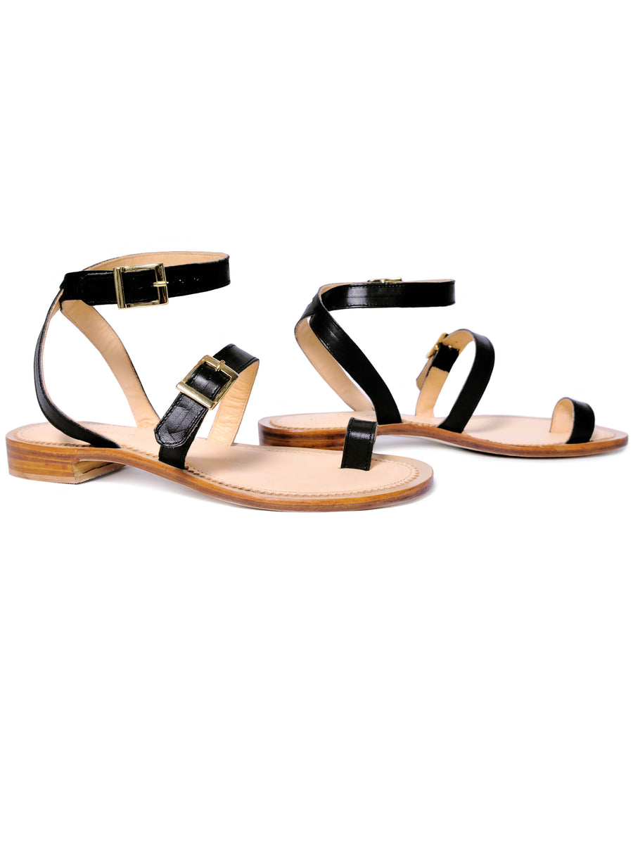 Black coloured, sustainable sandal with golden buckles by ALINASCHUERFELD