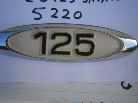Honda CB125  Sidecover badge NOS  Metal Non US Model  5220