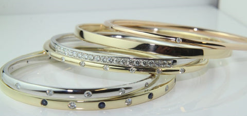 Bangles from recycled gold and gems