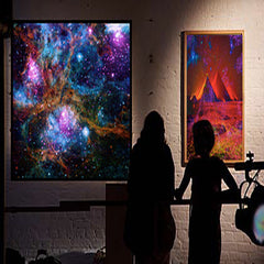 outer space art in gallery with 2 viewers