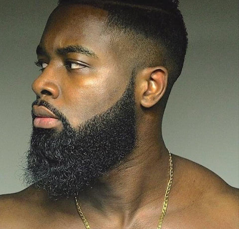 African American man with beautiful beard looking to his left