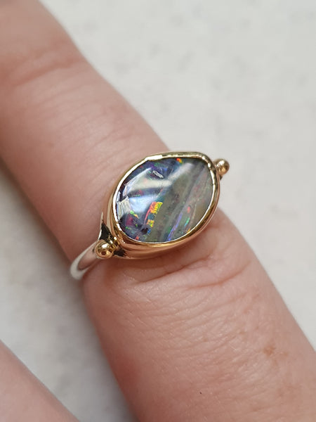 Solid Rainbow Boulder Opal, 14k yellow gold and silver ring