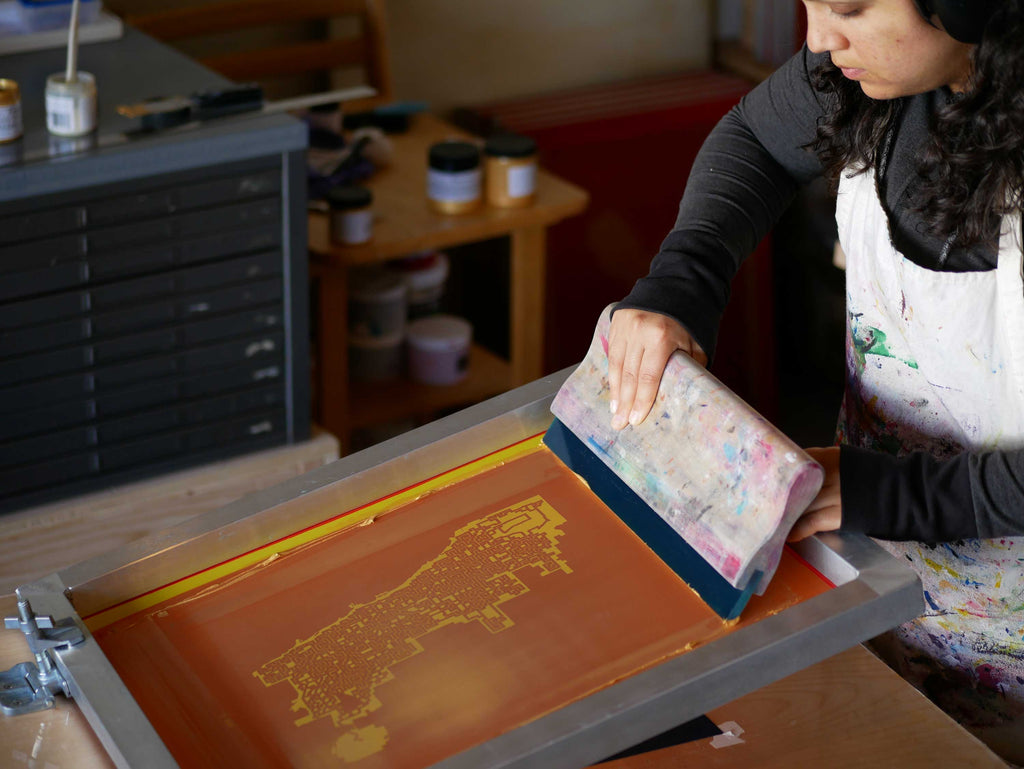 screenprinting gold ink on a vacuum table