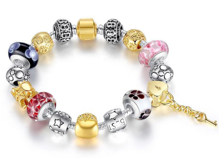 gold plating alloy combination bracelet with charms - Xingjewelry