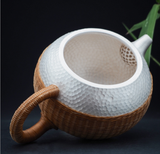 snow flake silver tea pot with weaved rattan
