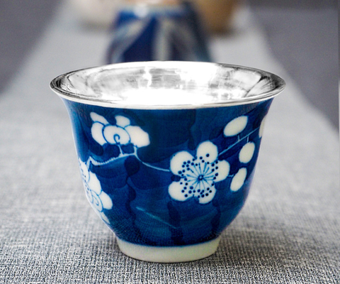 Snow flake silver cup with porcelain surface