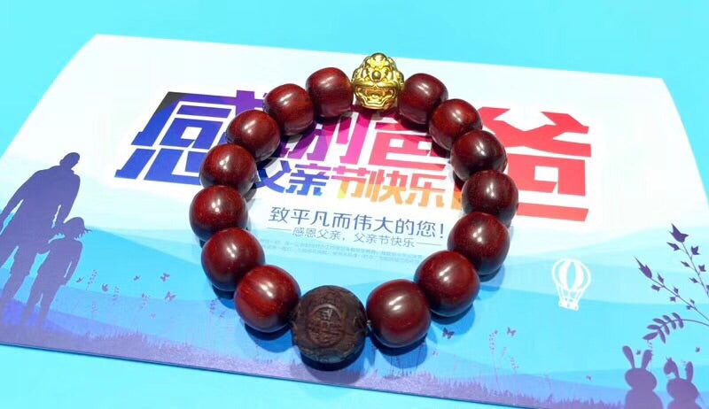 SOLID GOLD RED SANDALWOOD FOOTBALL ELASTIC BRACELET