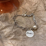 sterling silver bracelet with smile tag